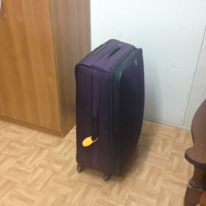 Solitary suitcase in room